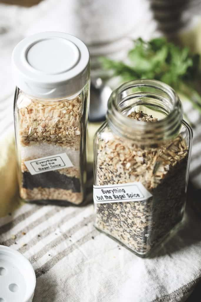 Two spice jars filled with everything bagel spice.