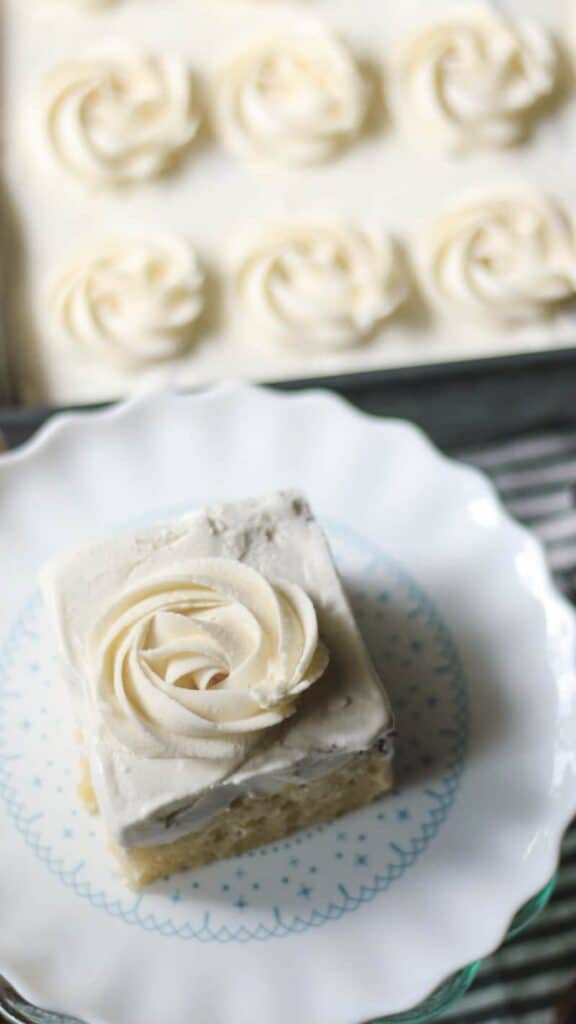 a square piece of cake with a buttercream rosette