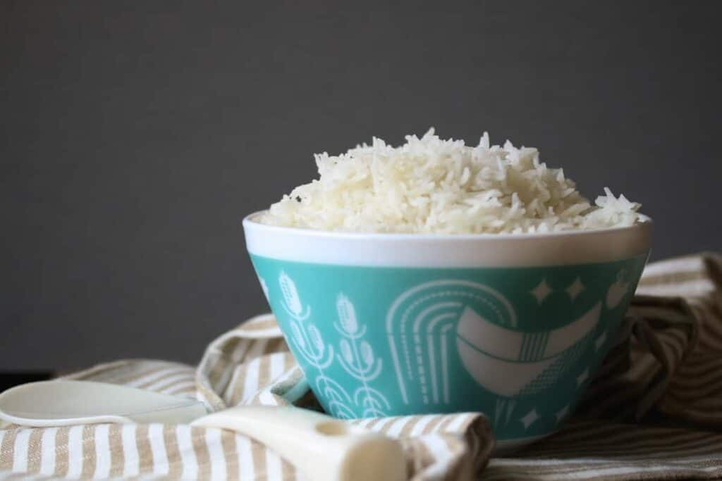 White rice in a pyrex bowl on a striped towel
