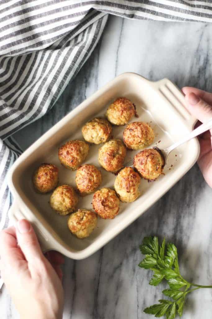 Baked Chicken Meatballs in Rectangular Le Crueset Dish