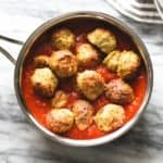 Baked Chicken Meatballs in a saucepan with red sauce