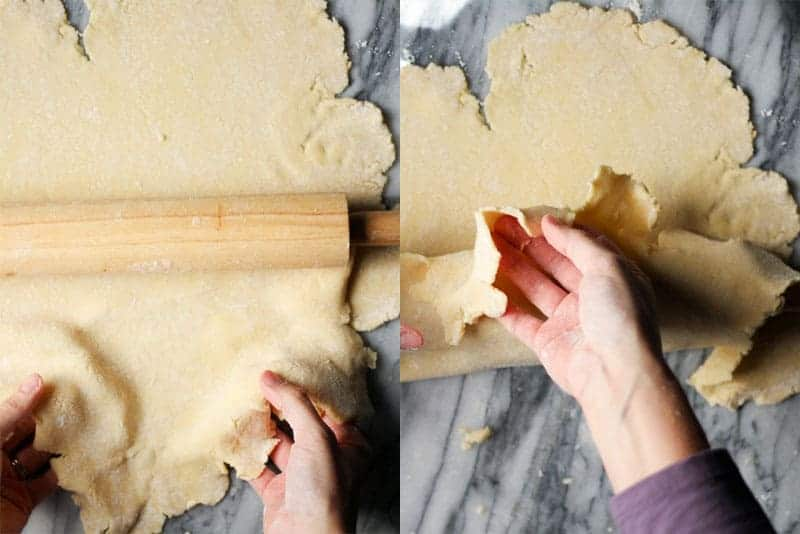 draping pie dough over a rolling pin