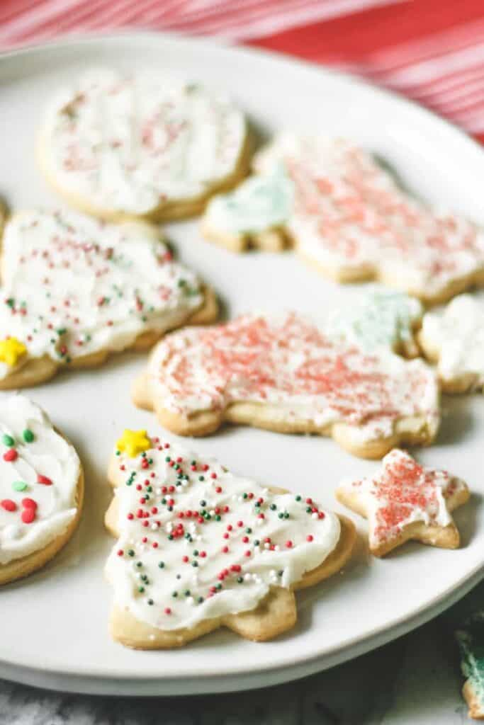 a plate of frosted sugar cookies
