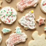 frosted gluten free sugar cookies on silicone mat
