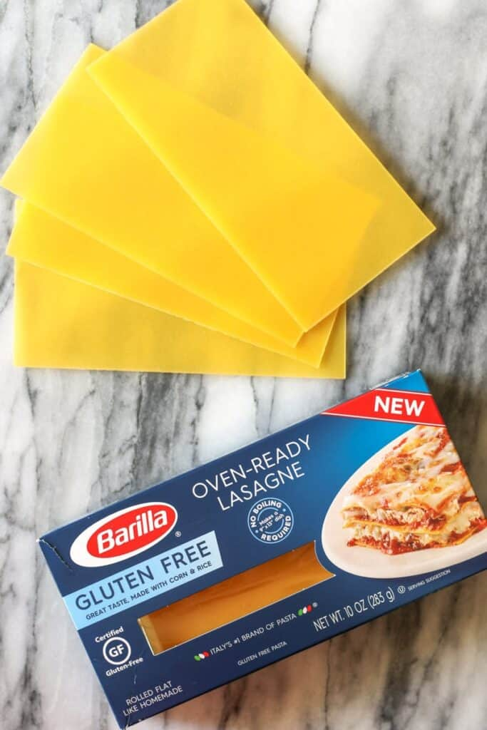 Barilla lasagna noodles, gluten free, 3 fanned out to show size and shape