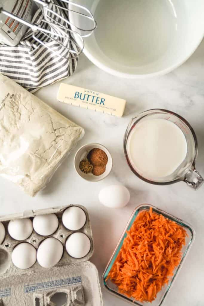 Ingredients for easy gluten-free carrot cake cupcakes with yellow cake mix.