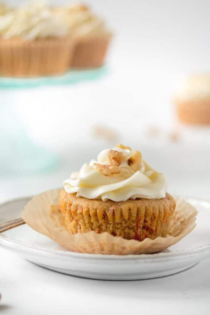 Unwrapped carrot cake cupcake.