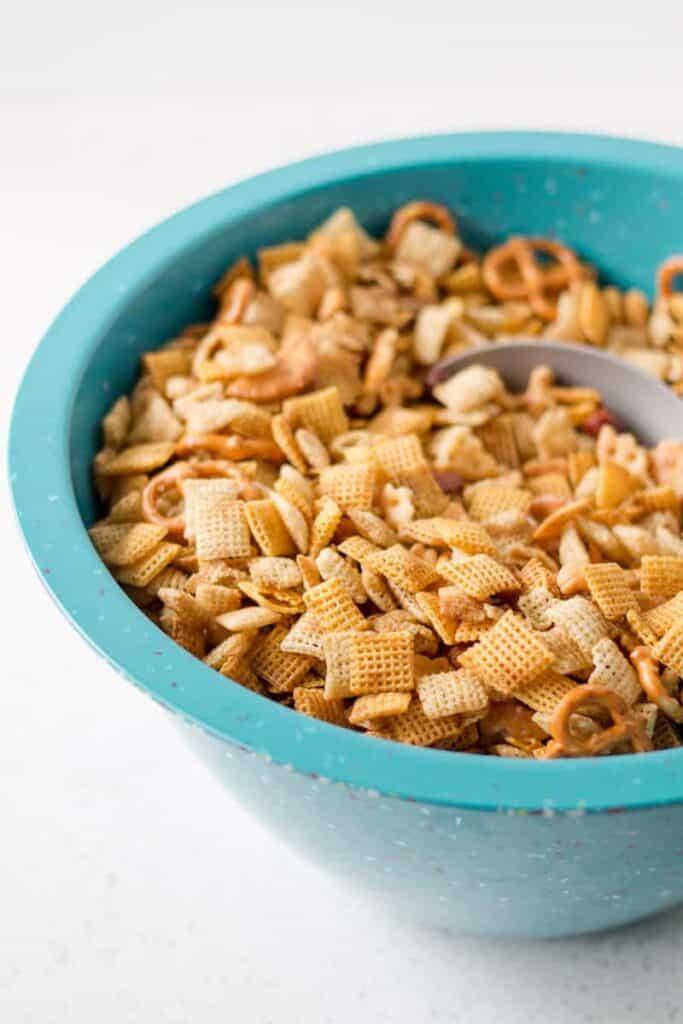 Gluten-free chex mix in a large Zak blue confetti bowl.