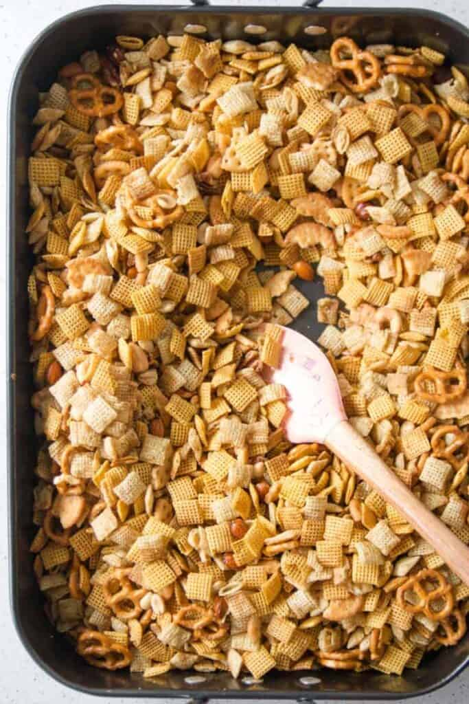 Gluten-free Chex mix in a large roasting pan.