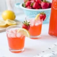 Two glasses of strawberry lemonade.