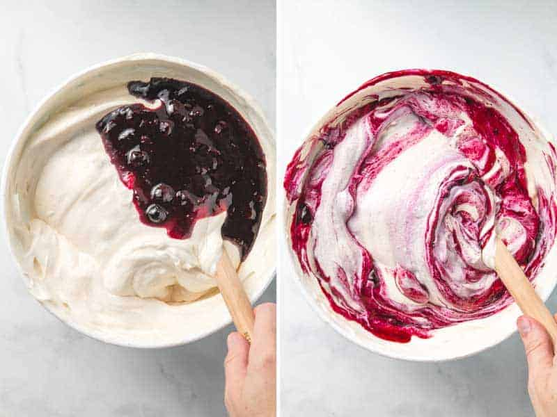Blueberry sauce is folded into the ice cream base, leaving vibrant purple swirls in the bowl.