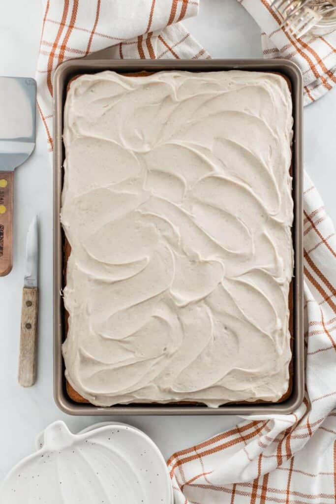 The entire pan of pumpkin bars with frosting swirls on top.