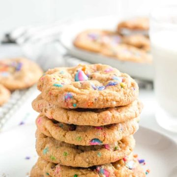 Unicorn Sprinkle Cookies stacked on a plate.