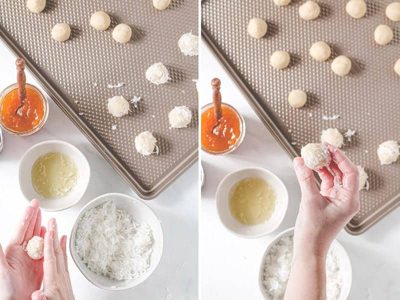 Rolling thumbprint dough between the palms of hands after rolling in egg white and coconut.