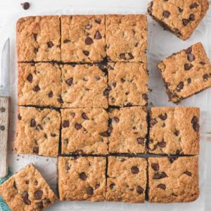 A batch of Gluten-free Oatmeal Chocolate Chip Bars cut into squares.