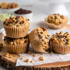 Gluten-free zucchini muffins lined up and two are stacked.