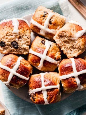 A plate full of gluten-free hot cross buns.