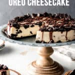 Gluten free Oreo cheesecake on a rustic cake stand.