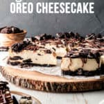 Gluten-free Oreo Cheesecake on a rustic wooden serving board.