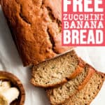 A partially sliced loaf of gluten-free zucchini banana bread.